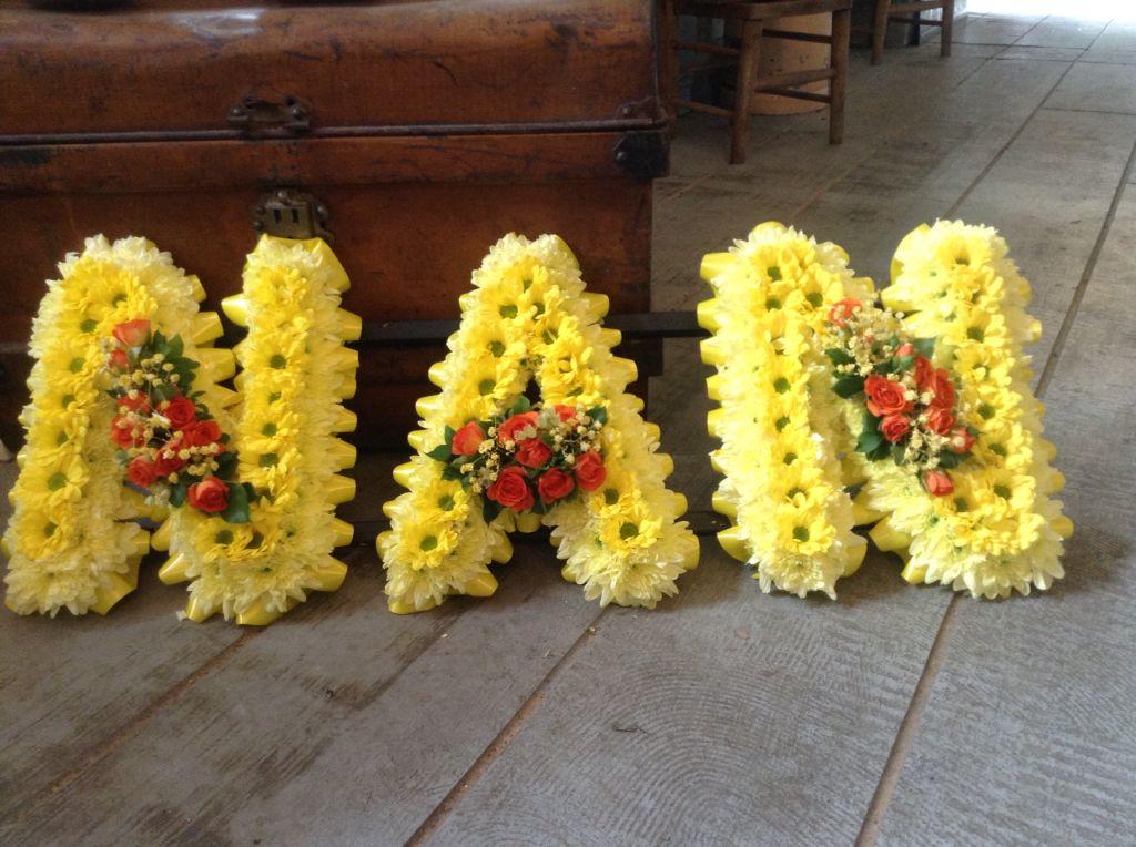 Funeral flowers nan letters funeral flower tribute lemon yellow funeral flowers nan letters funeral flower tribute lemon yellow orange flowers www mightylinksfo