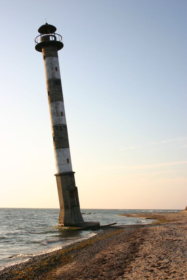 Kiipsaare Lighthouse, Harilaid Peninsula of Saaremaa Island, Estonia - stood 25 meters inland when it was built in 1933 but coastal erosion and rising sea levels put it offshore during high tide and caused it to lean seaward. It stands alone and abandoned as it continues to watch over the Baltic Sea.