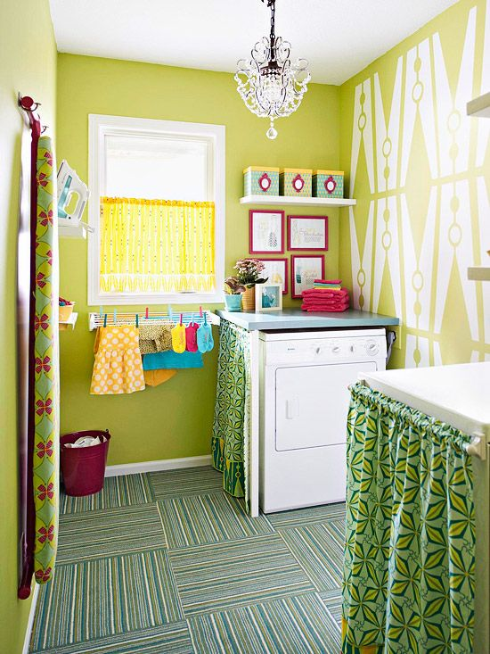 Lovely Laundry Decorative touches create an inviting aesthetic in this laundry room. The bold lime green, white, and pink color palette creates an uplifting atmosphere, making the often-dreaded laundry day a breeze. A playful wall mural of oversize clothespins breaks up the bold lime green hue and adds a splash of style in an unexpected place.