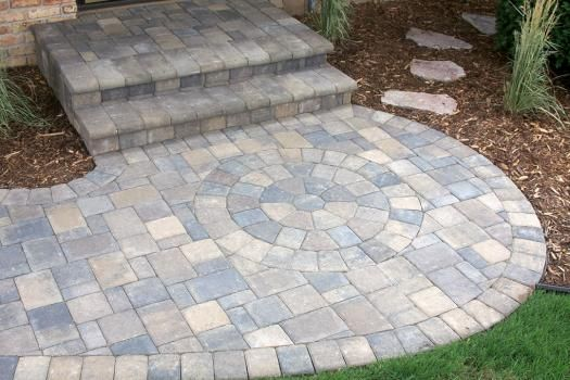 The inset circular paver design in the walkway adds flair ...