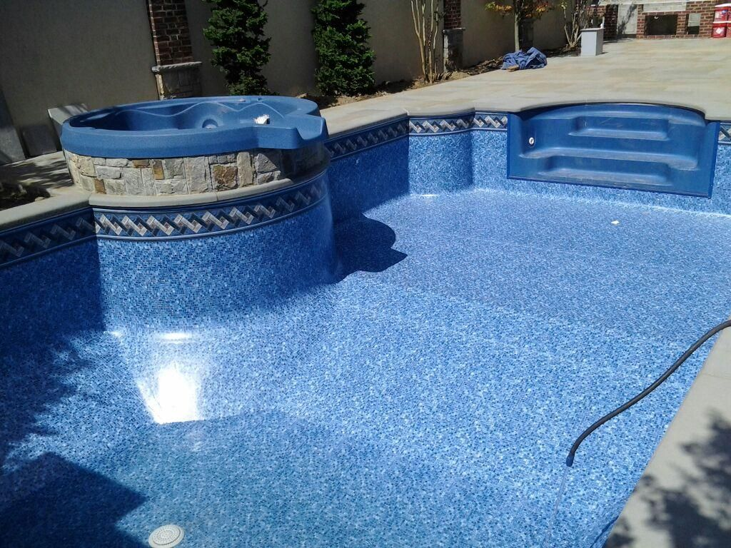 Swiming pools beach pebble on blue with liners that we for Blue pond liner