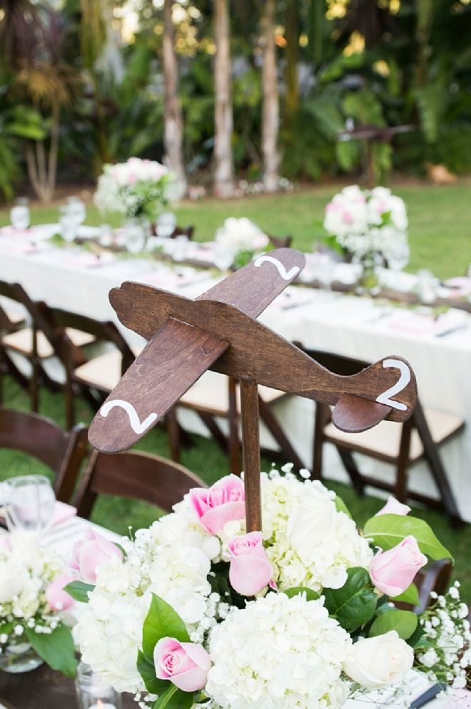 We Re Loving These Adorable Wooden Airplane Decor At This Wedding