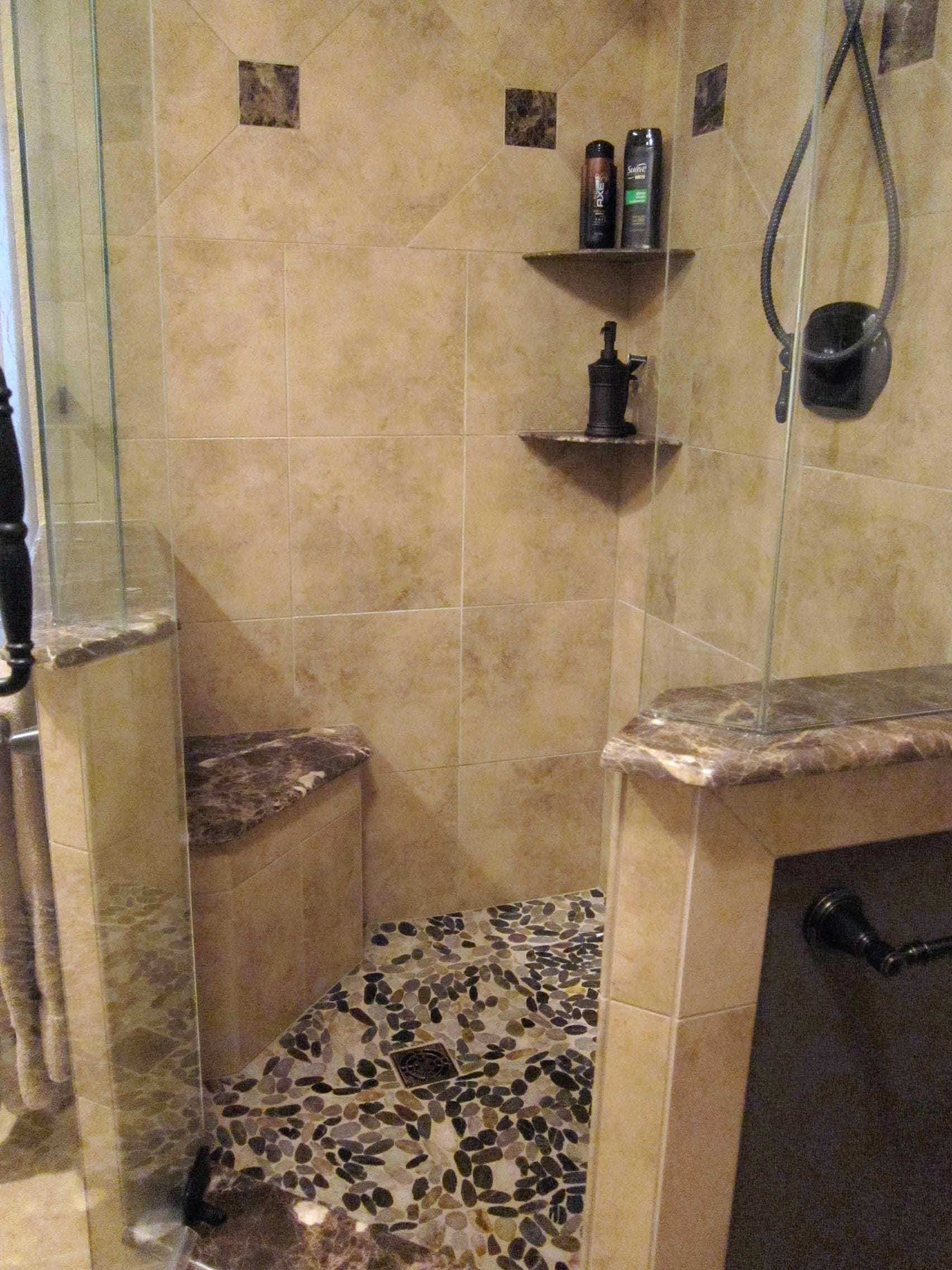 Tiled Shower With Dark Brown River Rock Floor And Corner Seat Love Bathroom