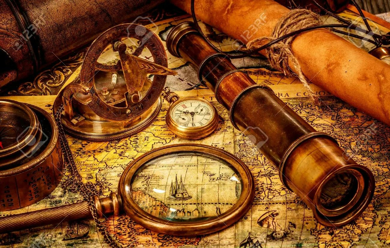 Pin by chris mcfadden jr on pirates pinterest vintage maps vintage magnifying glass compass telescope and a pocket watch lying on an old map stock photo gumiabroncs Images