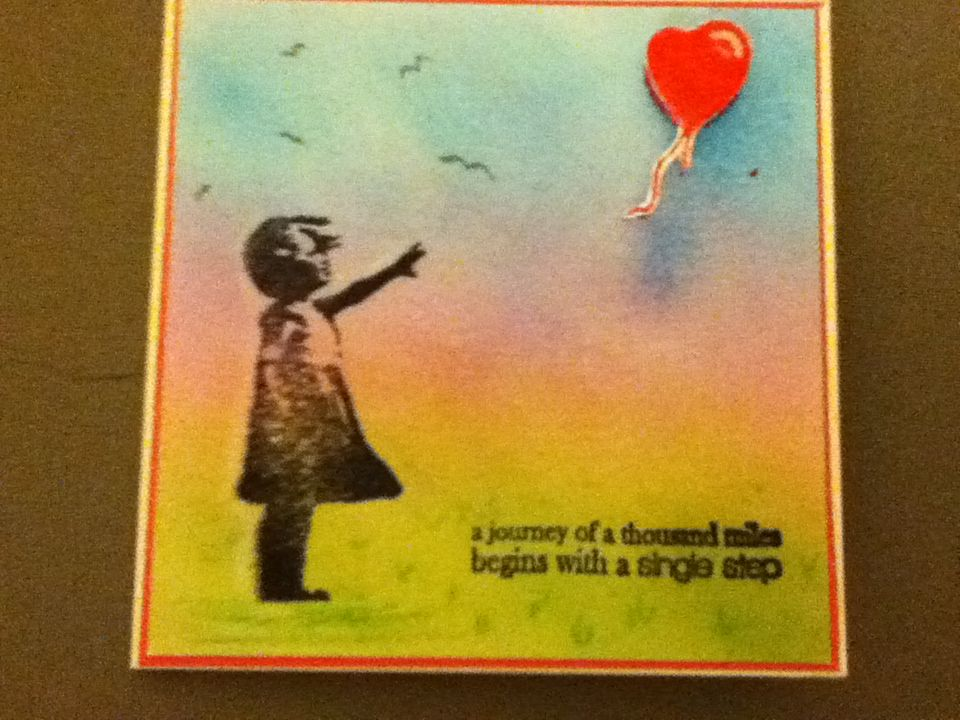 One of my cards - Banksy stamp on Distress Ink background. Love the girl reaching for the floating balloon