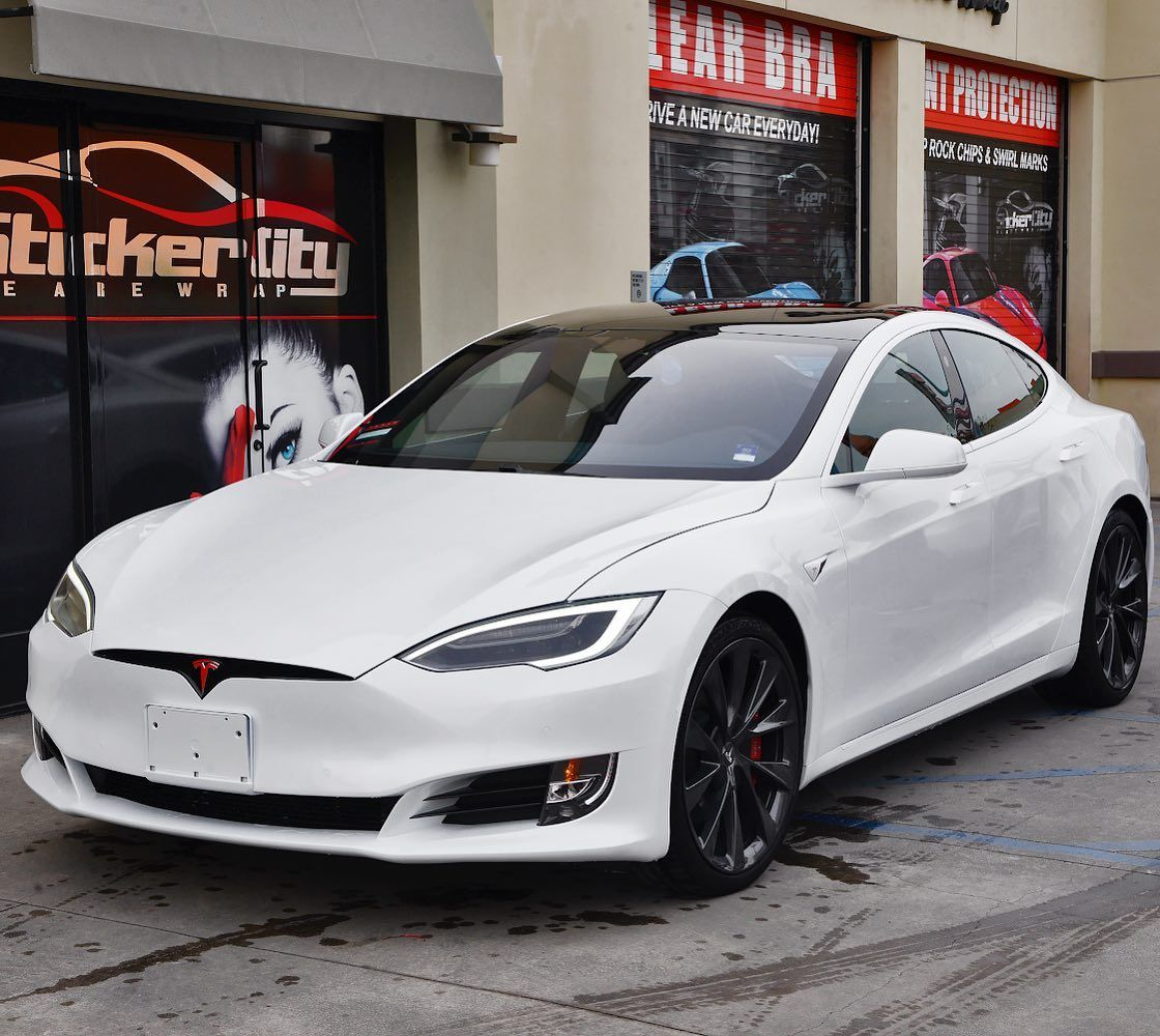 Tesla Model S With White Chrome Delete Black Powder Coated Wheels And Red Accents For Final Touch Tesla Model In 2020 Tesla Model S Black Powder Coat Red Accents