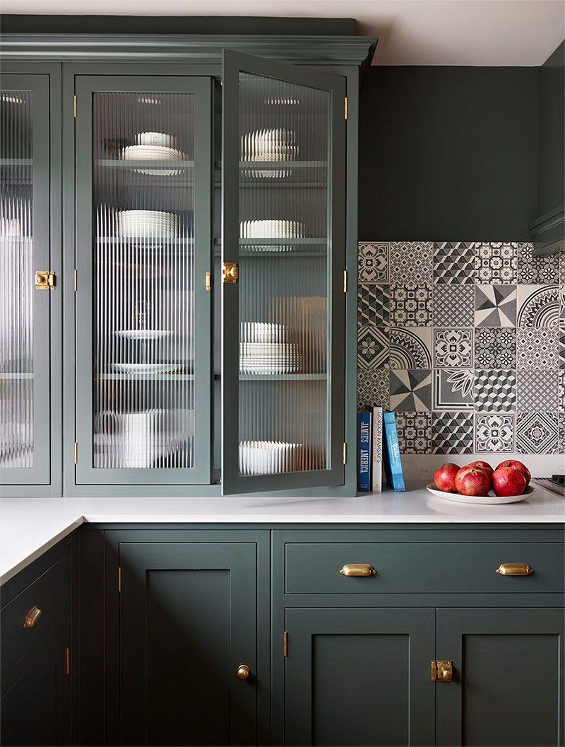 Deep Green Kitchen Cabinets With Brass Hardware And Black White Backsplash In 2020 Green Kitchen Cabinets Urban Kitchen Design Glass Kitchen Cabinets