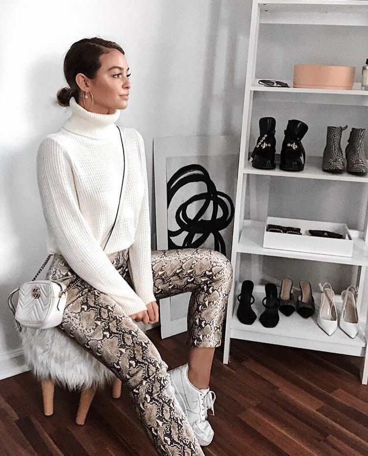 49ffa7b8728612 Kelsey Simone wearing a white turtle neck jumper with snake print lulu  leggings and a white Chanel bag