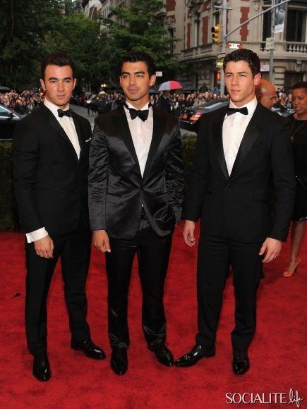 Nick Jonas, Kevin Jonas and Joe Jonas sport bow ties at the 2012 Met Gala at Metropolitan Museum of Art in NYC  - May 7, 2012
