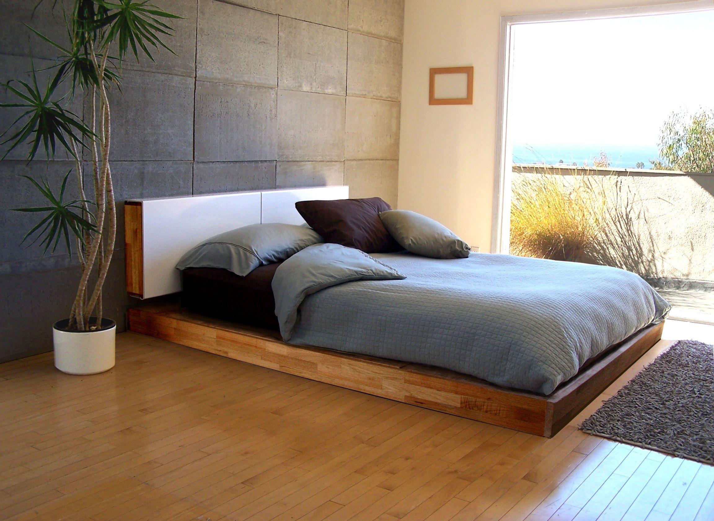 Brown Varnished Teak Wood Low Profile Bed Frame On Laminate Wooden