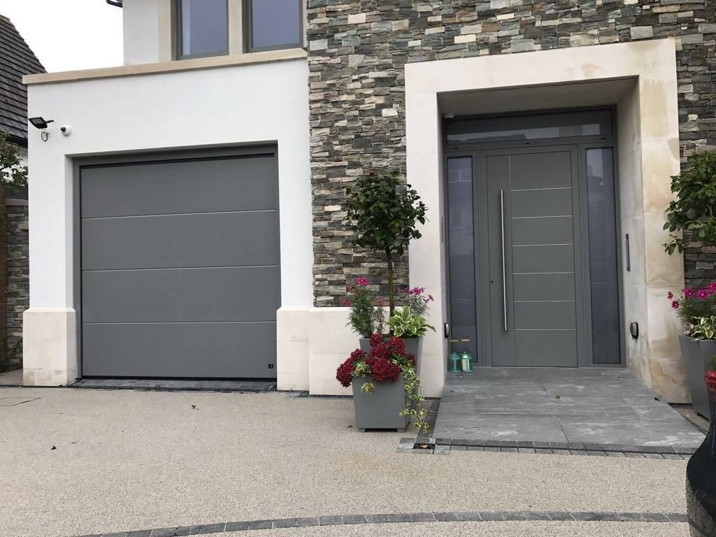 Modern Front Door And Sectional Garage To Match For More Designs Please Visit Our Website Www Cerberusdoors Co Uk