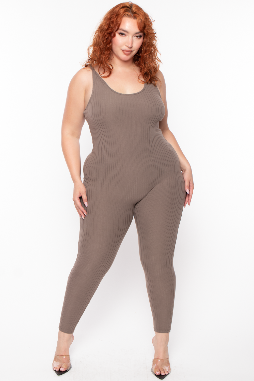 This plus size, stretch knit jumpsuit features a sleeveless design, a round neckline with tank straps a tapered skinny leg, and