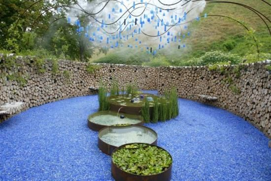 Charming Amazing Outdoor Space With Recycled Glass Gravel And Water Feature