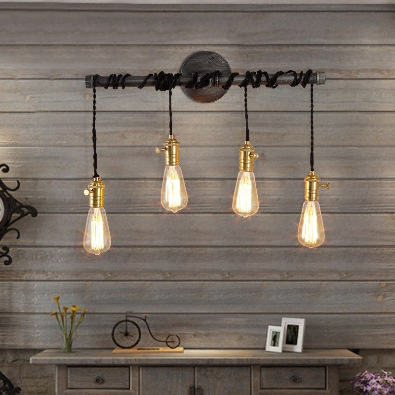 exposed bulb lighting. a slender horizontal plumbing pipe suspending four exposed vintage bulbs with black twisted wire makes this beautiful wall light and offers an array of bulb lighting