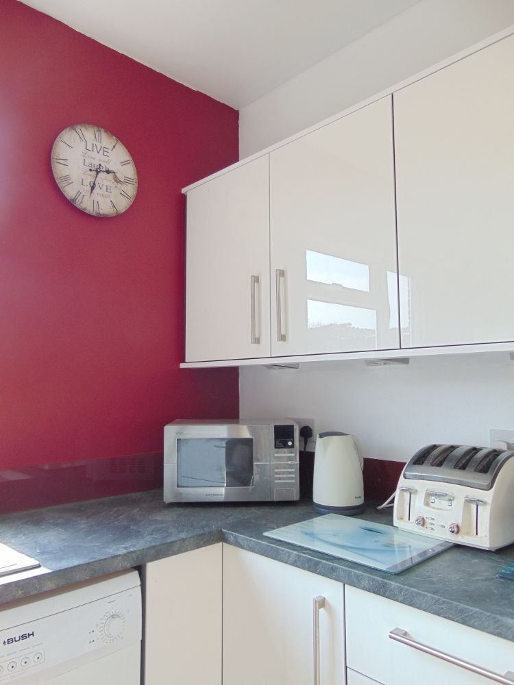 Red Kitchen With Walls A Feature Wall And Splashback Is Versatile Way To