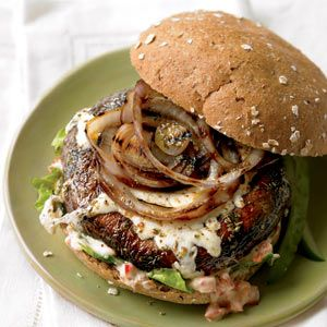 "Portobello Mushroom Melt: The secret to a satisfying, tastier-than-beef vegetarian ""burger""? Substitute portobello mushroom caps rubbed with oil and grilled, then layer on spicy condiments."