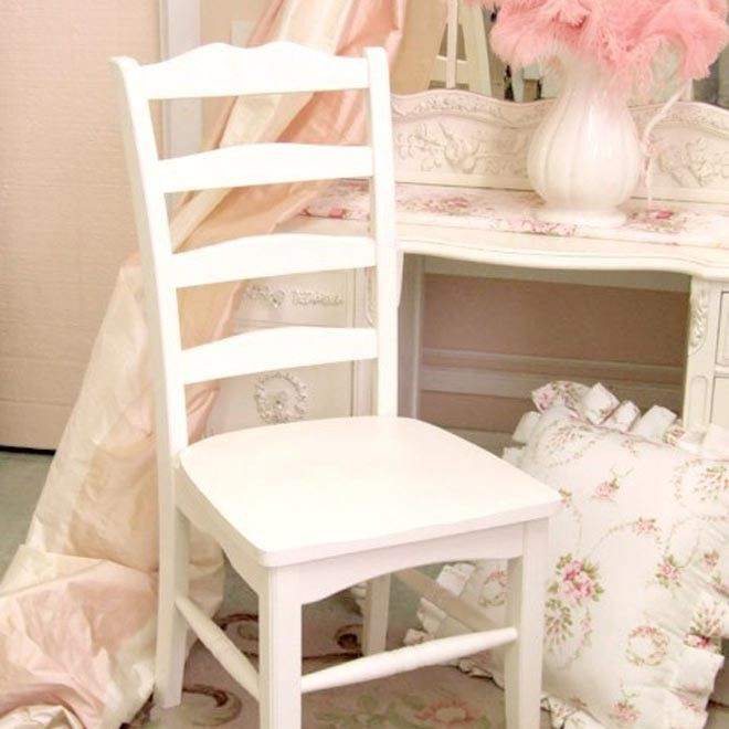 "This charming solid wood chair comes in white and is not distressed. It features a lovely ladder back which gives it a traditional look. Perfect as a dining chair or as a desk chair! A lovely floral cushion would complete the look! It is 17.5"" from the floor to the seat. Handmade in the USA!  38.5h x 17.5w x 18d"