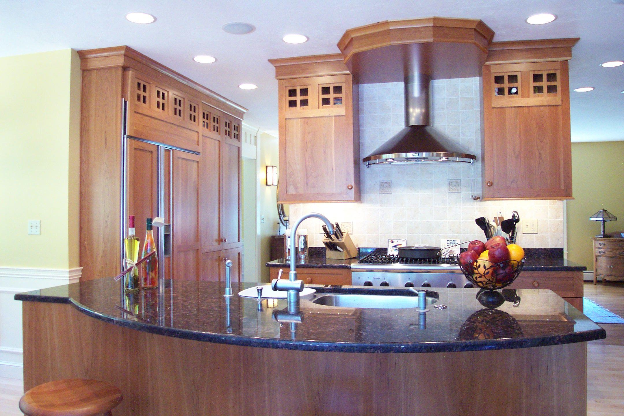 Transitional kitchen stainless steel appliances island sink built