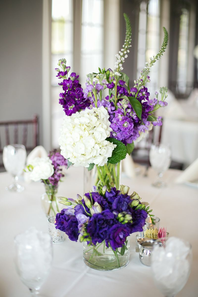 Love this purple and white centerpiece- grouping of various vases. // photo by Aubrey Marie Photography, http://theeverylastdetail.com/2013/09/20/a-classic-southern-purple-and-gray-texas-wedding/