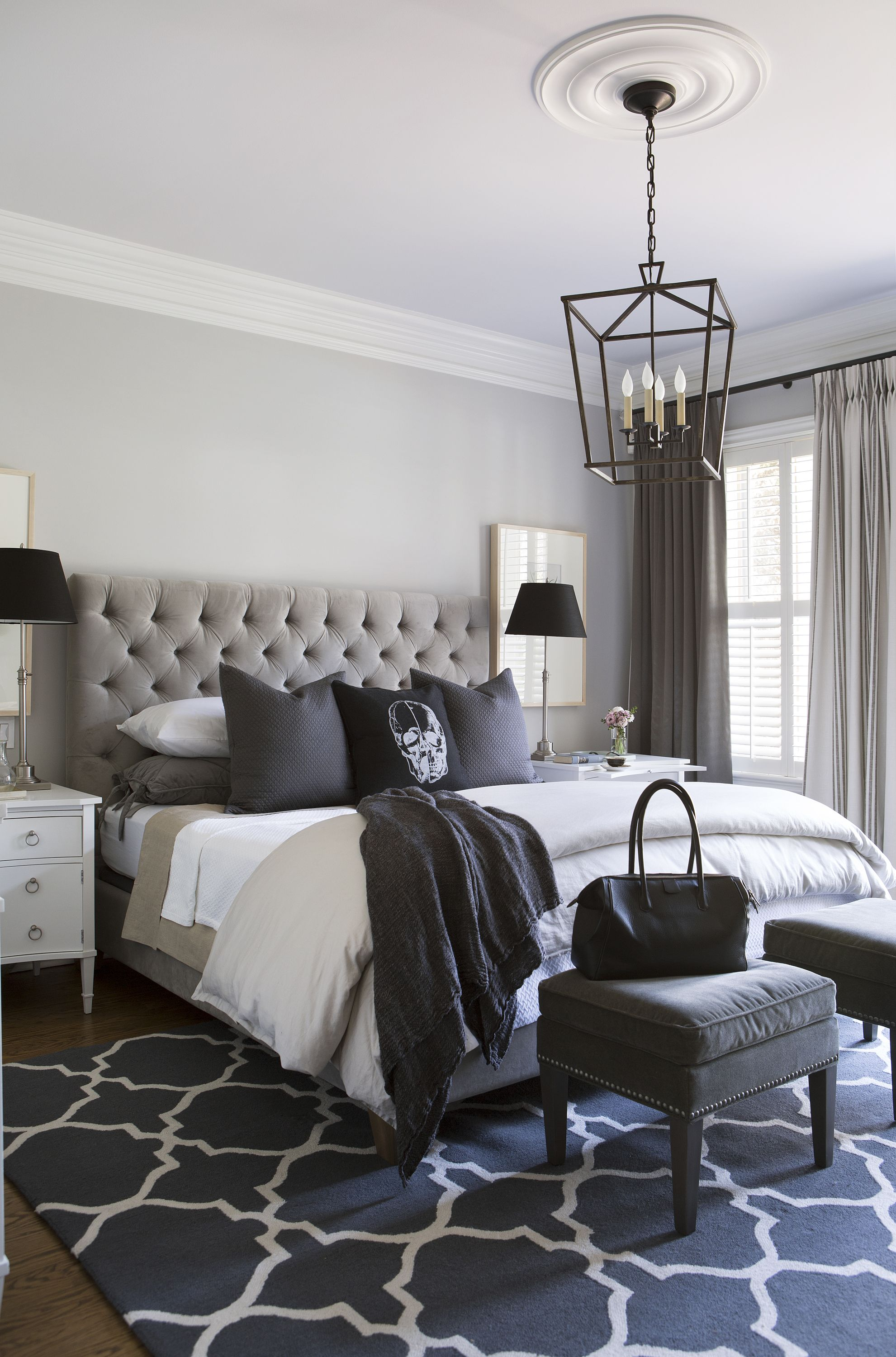 Master bedroom in greys and lavender with skull cushion jean