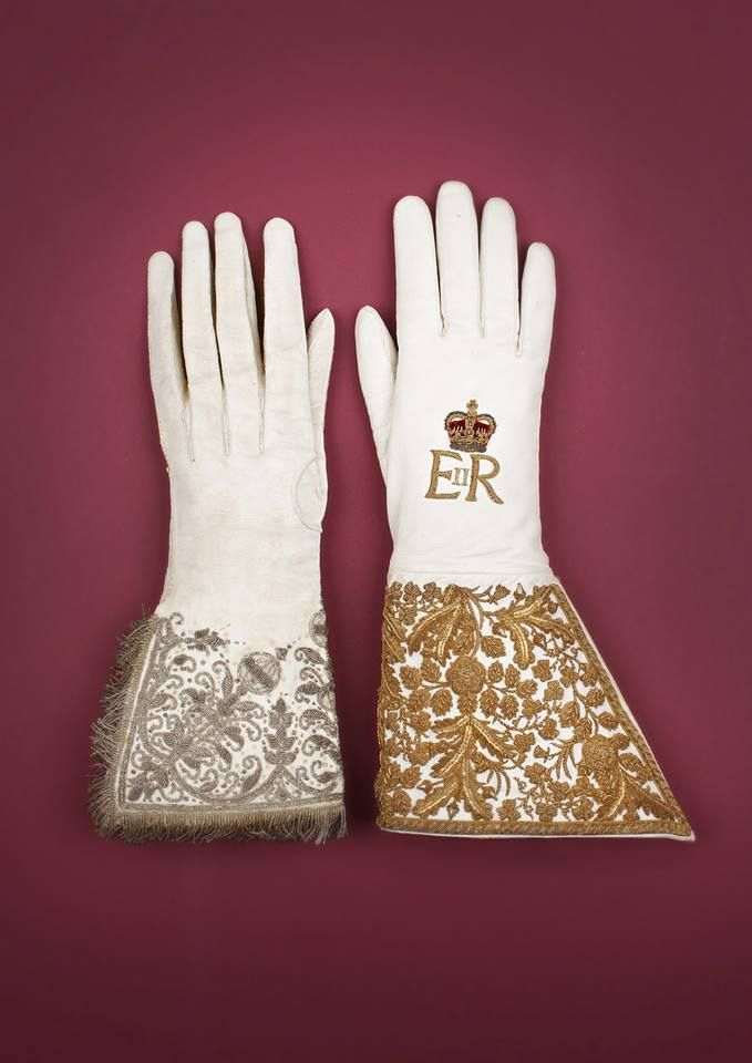 Queen Elizabeth II's special Coronation Glove [1953] (seen on right) was made by Dents.  The glove worn by Queen Elizabeth I for her Coronation is seen on the left.