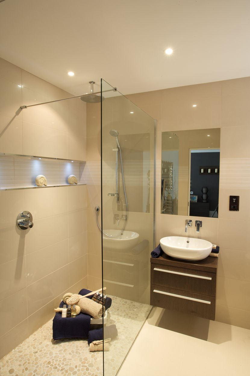 ensuite in neutral porcelain tiles walkin shower aqlcove with lights and walnut