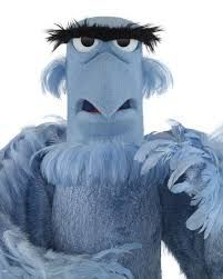 muppets - Sam the Eagle. Strong bold straight eyebrow. Perfectly mirrored features in face, straight sides to face in the square shape. Bold sense of right and wrong in personality.