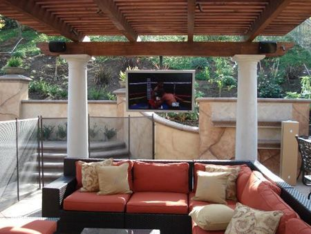 Enjoying Your Outdoor Tv Luxurite Outdoor Tv Systems Used For Outdoor Entertainment Patio Tv Backyard Patio Patio Design