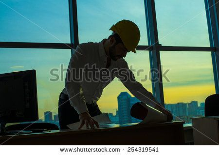Silhouette builder engineer wear security helmet look at blueprint silhouette builder engineer wear security helmet look at blueprint paper construction drawing plan on background of malvernweather Gallery