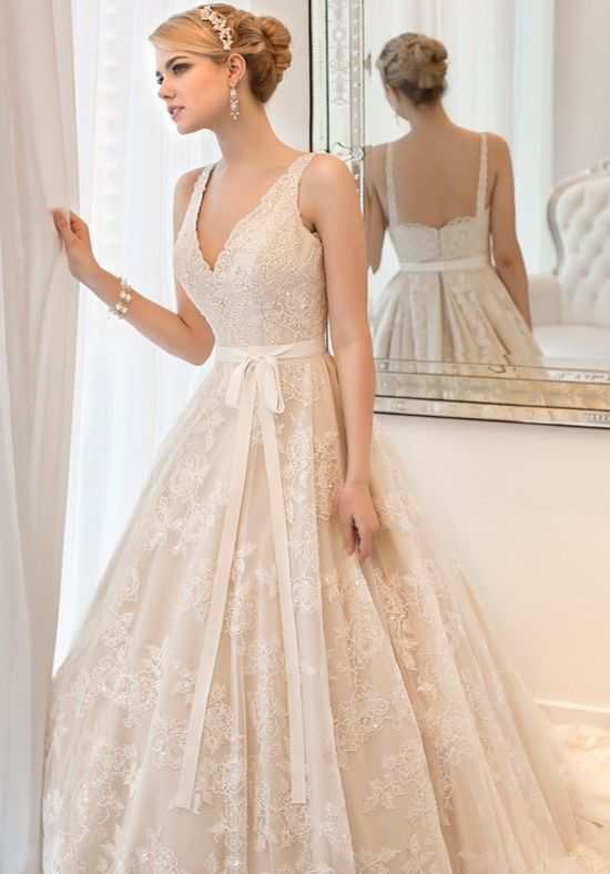 Vintage-inspired corded lace ball gown with hand-sewn jewles ...