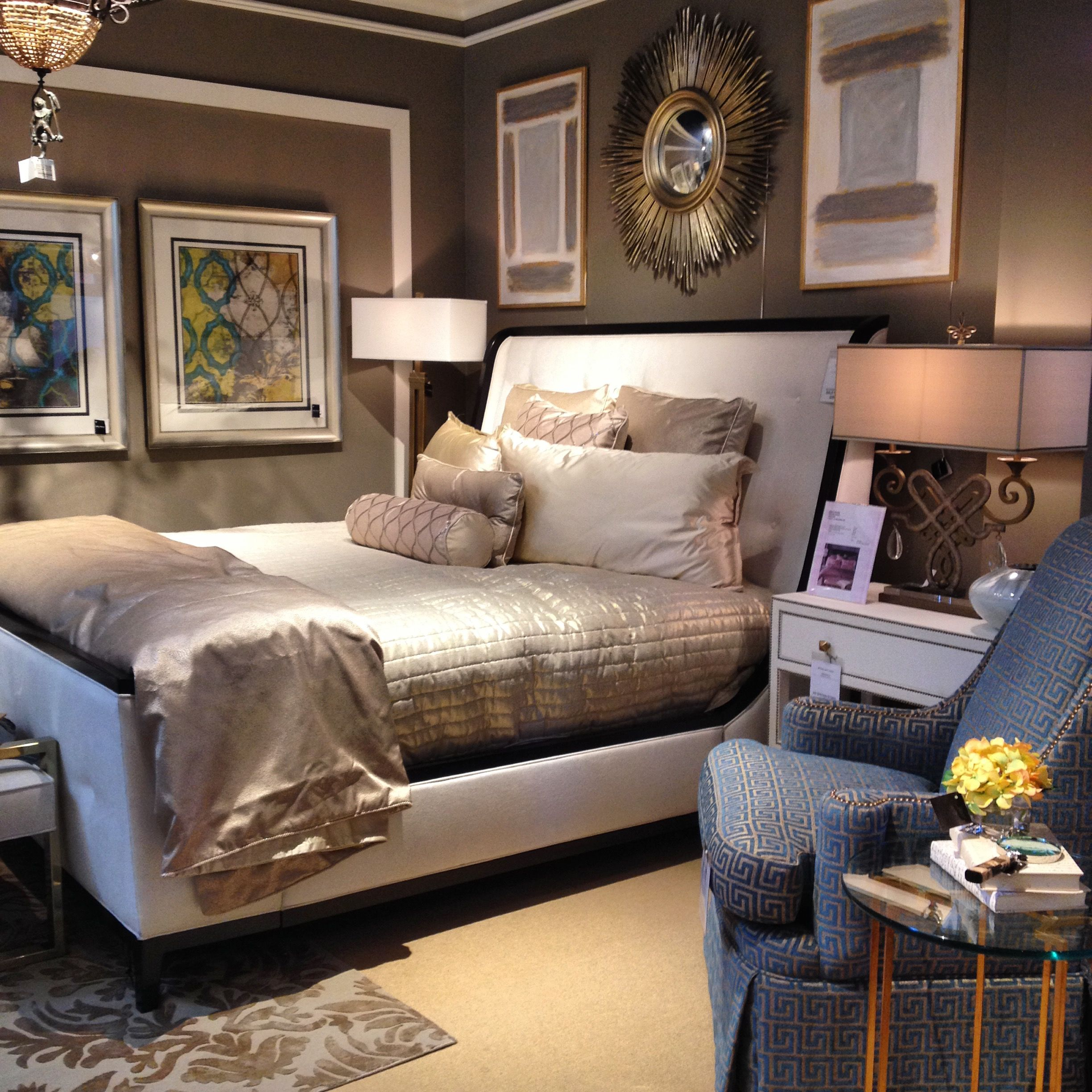 Hanging artwork above your bed can make the headboard feel
