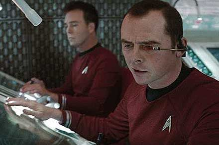 Chris Doohan (Scotty's son) Into Darkness. 3rd viewing of Into Darkness and realization dawned on me that he plays the transporter engineer who beams Spock down to catch Khan. In this image, he's behind Simon Pegg as Scotty. Watch him continue his father's legacy in Star Trek Continues #StarTrekIntoDarkness