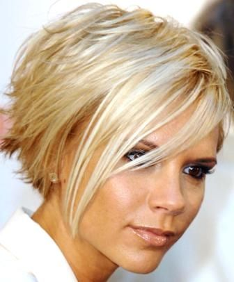 Victoria Beckham. Love her hair next year I go this short by 50 I want a pixie no 35 year old should be wearing her hair past her ta tas shame on you act your age tee he he