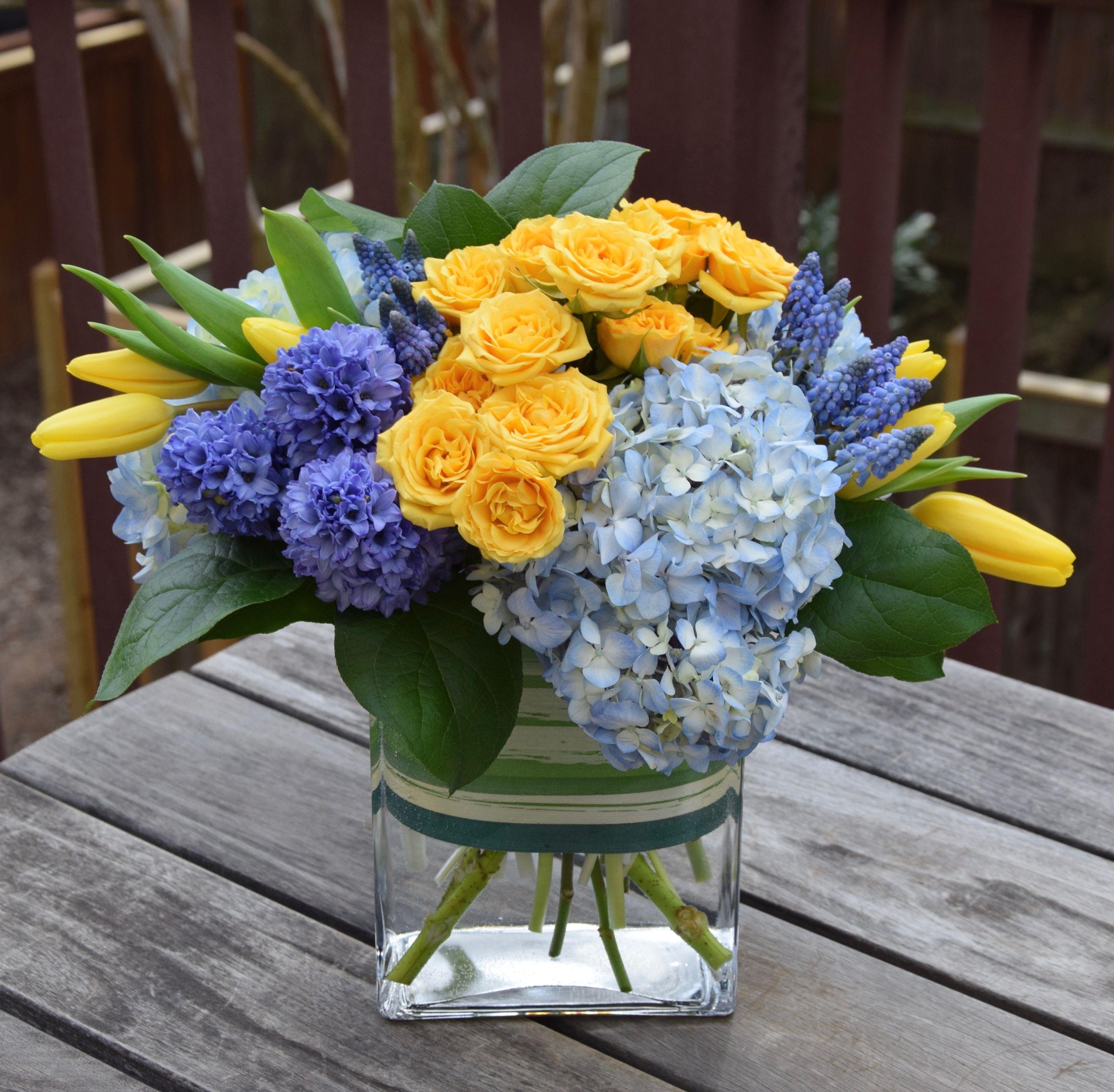 Sympathy Flower Arrangement With Hyacinths Hydrangeas Muscari Tulips And Spray Roses Fresh Flowers Arrangements Flower Arrangements Sympathy Flowers