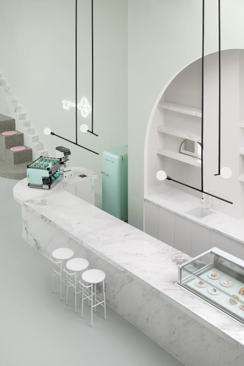biasol combined marble surfaces with geometric elevations and pastel hues as a nod to wes andersons cafe interior - Marble Cafe Decoration