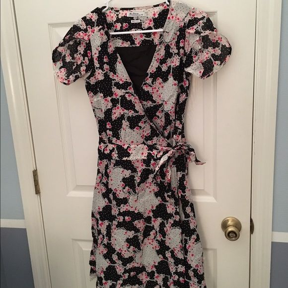 Reduced Ben Sherman Floral Wrap Dress Brand new Ben Sherman floral wrap dress with cap/flutter sleeves, size XS. I took the tags off and it's wrinkled from hanging in my closet for a while but it's never been worn. It can fit a size small as well because of the wrap style. It is a v-neck, the solid black you see in the picture is the lining in the back of the dress. Ben Sherman Dresses