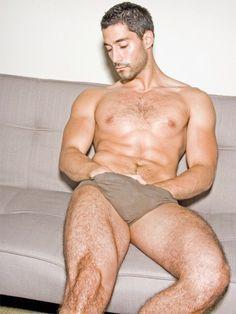 Naked males between legs sex