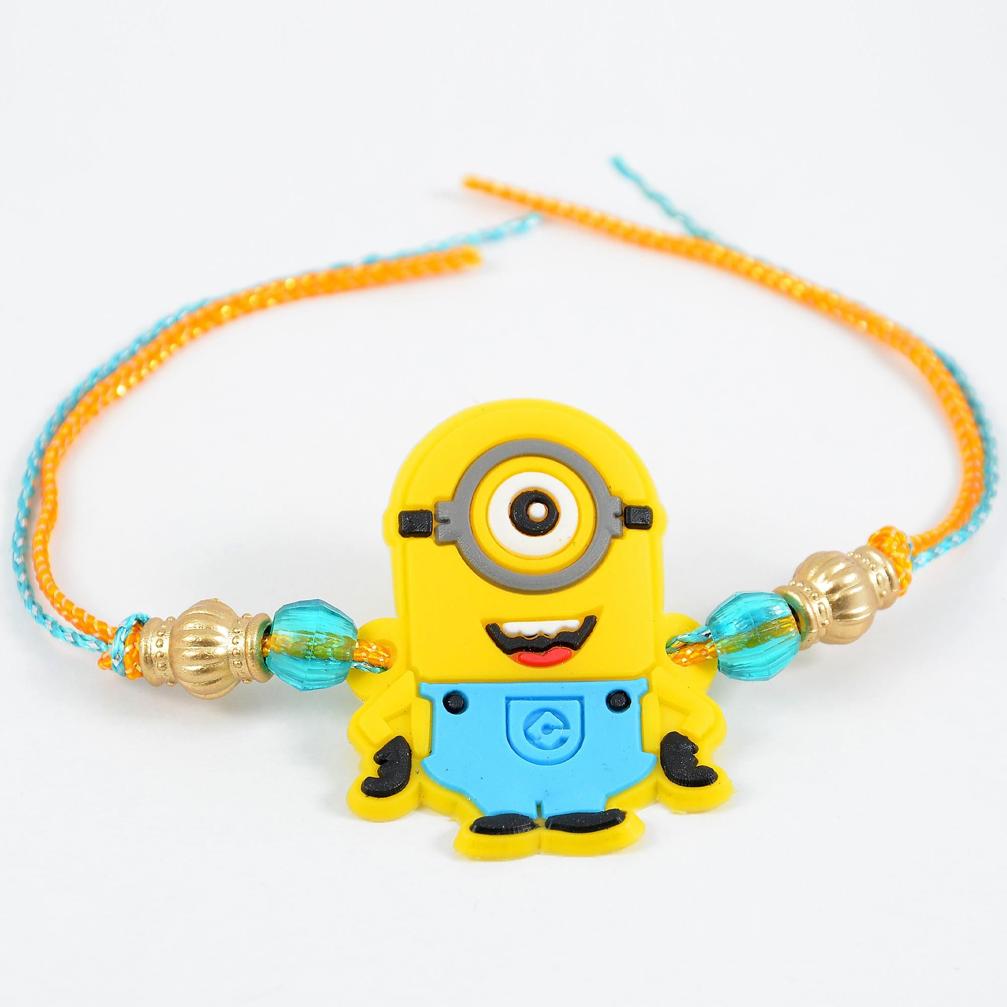 Delightful Yellow Minion Rakhi : The rakhi features a minion from the popular children's movie despicable me along with blue and bronze beads and yellow and blue zari threads.