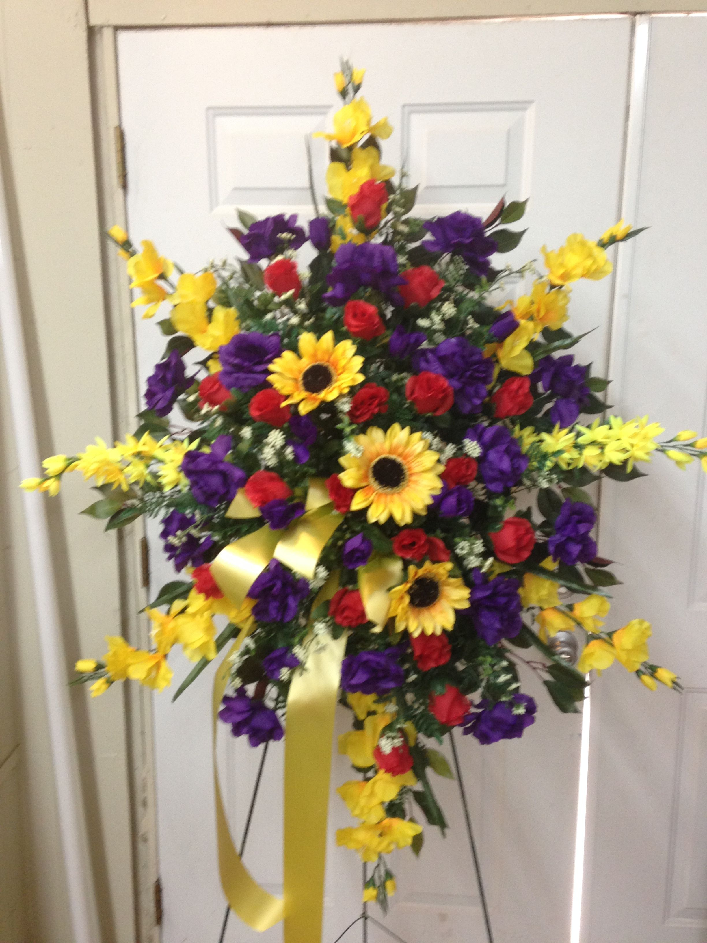 Silk funeral spray using yellow gladiolus yellow sunflower purple silk funeral spray using yellow gladiolus yellow sunflower purple roses red rose buds and white filler flowers with yellow ribbon streamers izmirmasajfo