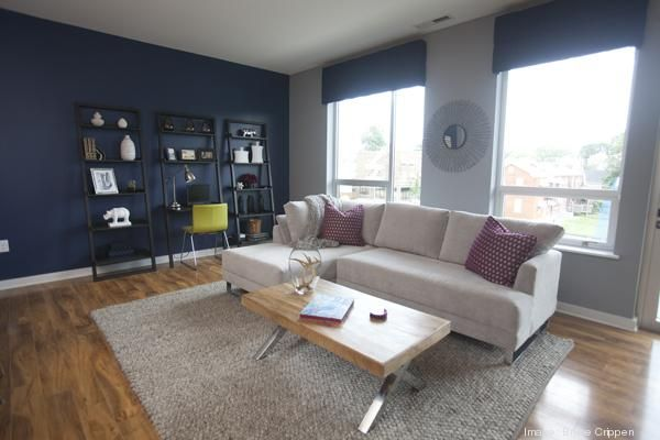 The Living Room In One Bedroom Model At Has A Navy Blue Accent Wall