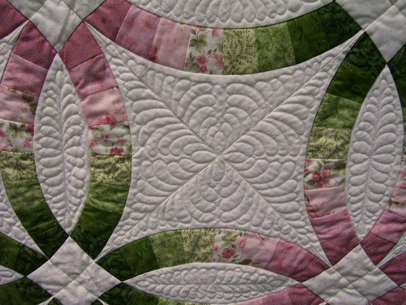 Quilting Designs For Wedding Ring Quilts : Quilting on a customer s double wedding ring quilt quilting designs Pinterest Double ...