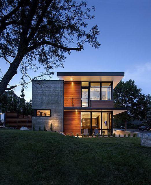 Modern Home Exteriors: A Modern Family Home For Racing Bike Enthusiasts