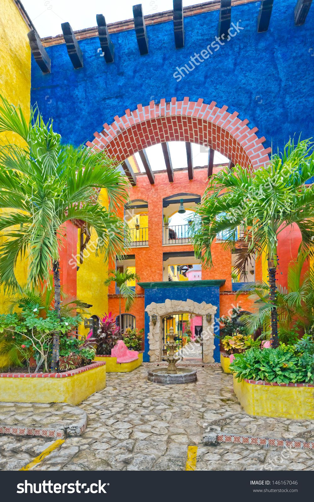 Stock Photo Fragment Of The Mexican Building In Traditional Caribbean Style Colorful Inner Court Yard Plaza 146167046 999x1600