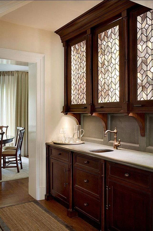 this is a simpler butlers pantry that seems to connect the kitchen and dining roo glass on kitchen cabinets with glass doors on top id=97587