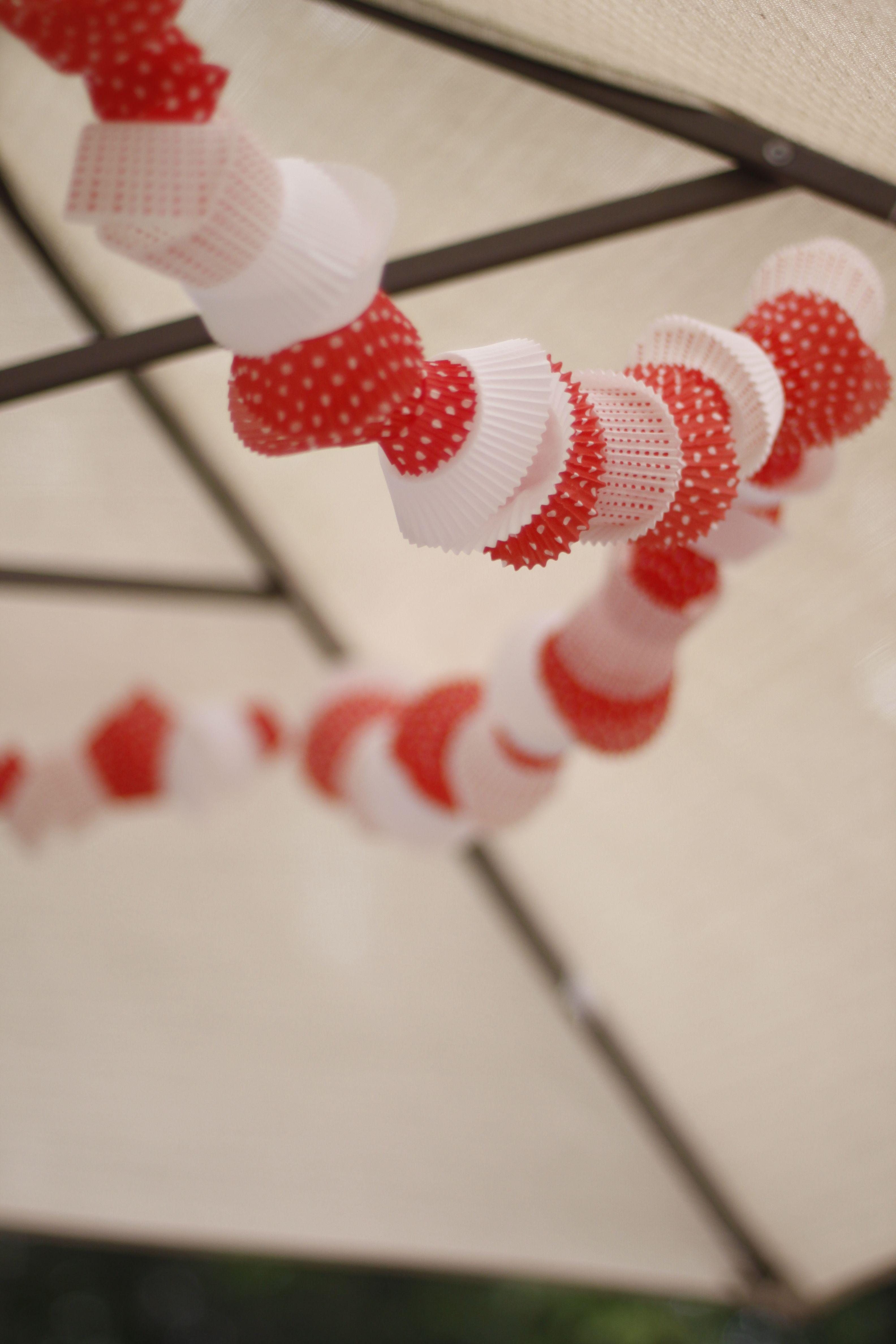 Cupcake wrapper garland attached to patio umbrella