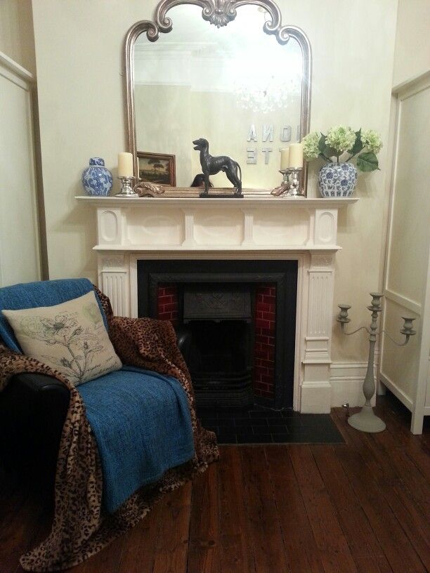 Eclectic bedroom, Chinese inspired influences with leopard print chair and Edwardian fireplace
