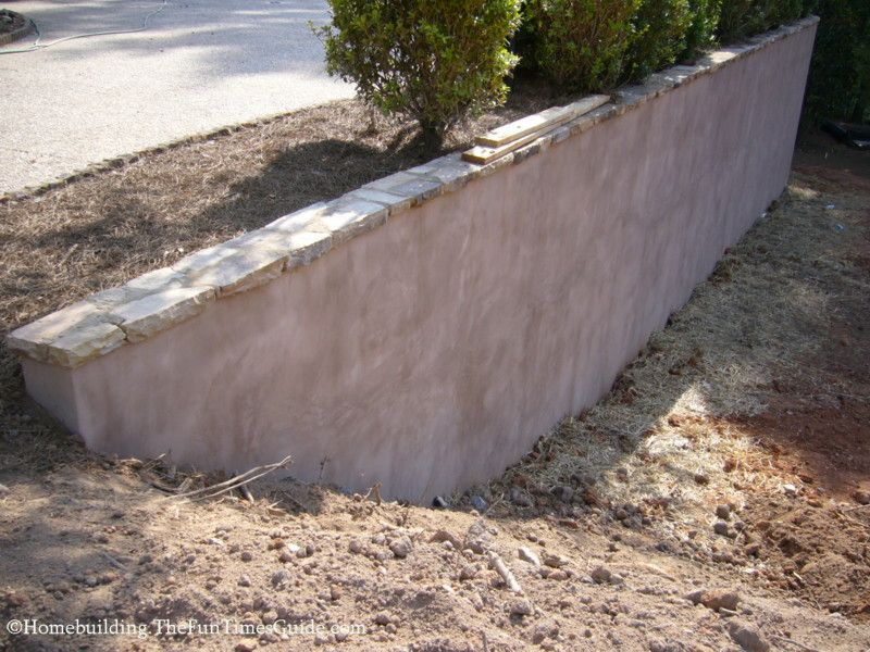 How To Improve The Look Of A Concrete Retaining Wall Concrete Retaining Walls Landscaping Retaining Walls Backyard Retaining Walls