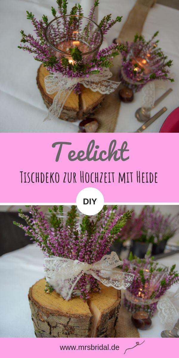 Windlichter mit Heide als Tischdeko für eine Herbst Hochzeit #herbstlichetischdeko