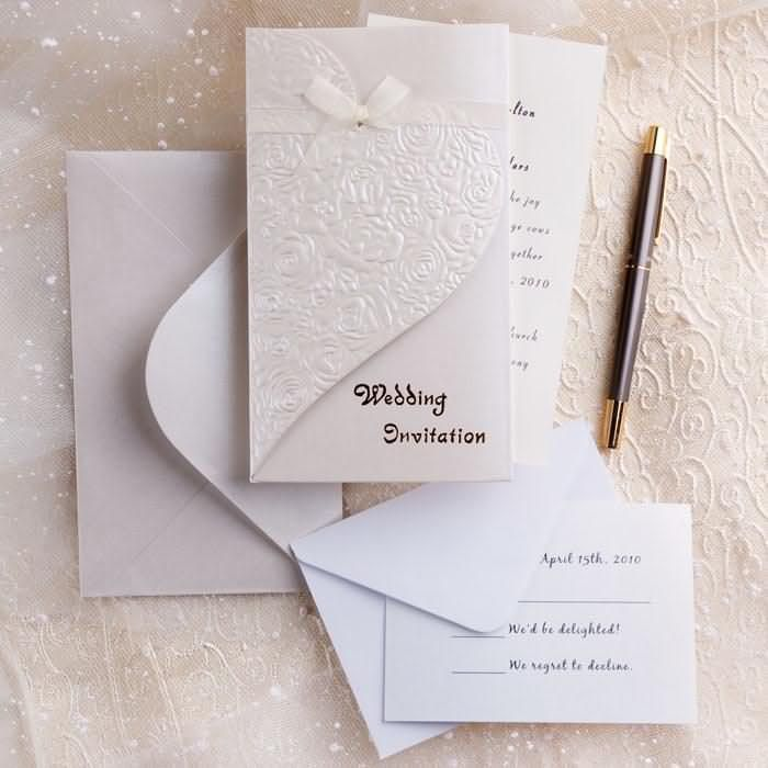 Elegant ivory embossed tri fold wedding invitations with ribbon elegant ivory embossed tri fold wedding invitations with ribbon filmwisefo