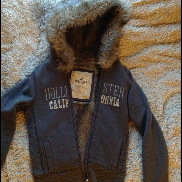 Fur Lined Hollister Sweatshirt Faux fur but looks real. Still in great condition. Would be keeping this but it no longer fits! Super warm and perfect for the upcoming winter. Says medium as size but it would def fit a small Hollister Jackets & Coats